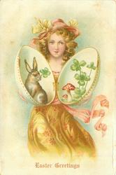 golden haired girl in golden dress holds open hinged Easter egg containing rabbit, 4 leaf clover & toadstool