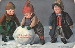 three doll children have made an enormous snowball