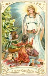A HAPPY CHRISTMAS angel in white offers tray of food to three children sitting in front of xmas tree left