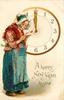 A HAPPY NEW YEAR TO YOU  woman reads valentine in front of clock  image##