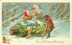 LOVING CHRISTMAS GREETINGS small girl on sled of evergreen has hands warmed by larger girl, in a snow storm