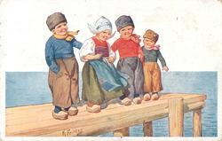 four Dutch children stand in line on dock