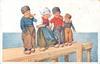 four Dutch children stand in line on dock