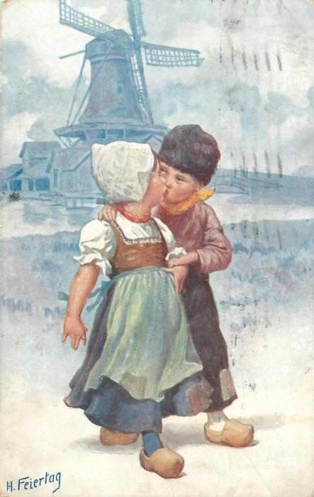 Dutch girl & boy are kissing front, big windmill behind