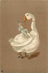 manniken in blue riding large white goose facing right looking back