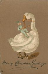 MERRY CHRISTMAS GREETINGS  manniken in blue riding large white goose facing right looking back