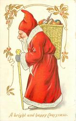 A BRIGHT AND HAPPY CHRISTMAS Santa in red coat with white trim, carries stick, wicker basket on shoulder walking & looking left