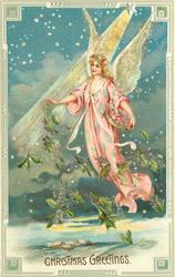 CHRISTMAS GREETINGS star above angel in pink dress floating & holding evergreen, many stars above & behind