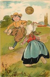 Dutch boy & girl playing soccer