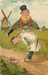 two Dutch boys playing leap-frog