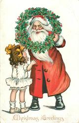 CHRISTMAS GREETINGS  santa peers through holly wreath at girl in white