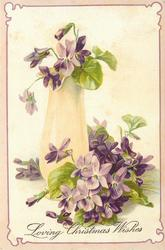 LOVING CHRISTMAS WISHES violets in tall cream glass vase & around