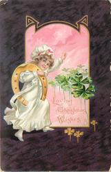 LOVING CHRISTMAS WISHES  girl in white dress has large lucky horseshoe over her shoulder, 4 leaf clover right