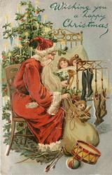 WISHING YOU A HAPPY CHRISTMAS  Santa sitting by bed, two sleeping children, bag of toys