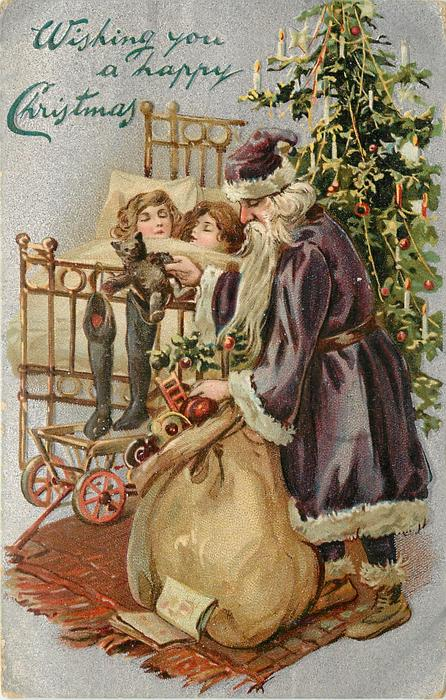 WISHING YOU A HAPPY CHRISTMAS  purple robed Santa right in front of tree, two children asleep