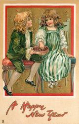 children, boy and girl sit on chairs eating chocolates
