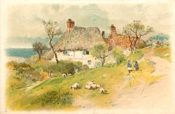 2 children & sheep on grass in front of cottages
