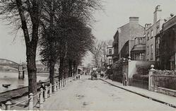 THE TERRACE street with houses to right, trees & river left