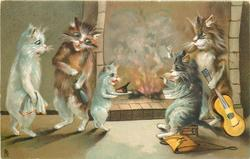 four cats & a kitten in front of fire, one to right holds violin, another opens wine