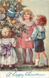 A HAPPY CHRISTMAS, three children admire tree