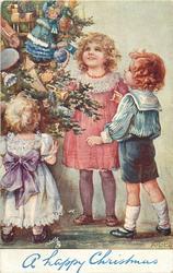 A HAPPY CHRISTMAS  three children admire tree