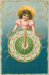 A HAPPY NEW YEAR  girl dressed in pink wears straw hat and leans on clock