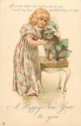 A HAPPY NEW YEAR TO YOU  girl in floral dress, caresses dressed puppy on chair