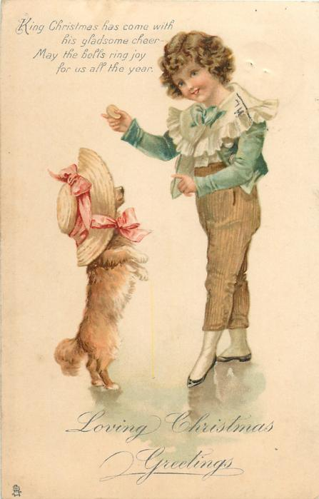 LOVING CHRISTMAS GREETINGS  boy holds cracker for begging dog wearing bonnet standing on hind legs
