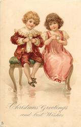 CHRISTMAS GREETINGS AND BEST WISHES  boy and girl sit on green bench, both eat ice-cream