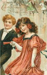 CHRISTMAS GREETINGS  boy in black suit, girl in red dress move left
