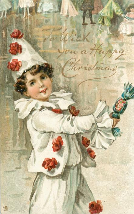 TO WISH YOU A HAPPY CHRISTMAS  boy in pierrot costume holds out a cracker,faces right, dancers in background