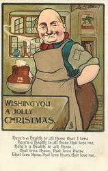 WISHING YOU A JOLLY CHRISTMAS  bald publican wearing brown apron holds brown/white jug of ale in right hand, left hand in pocket