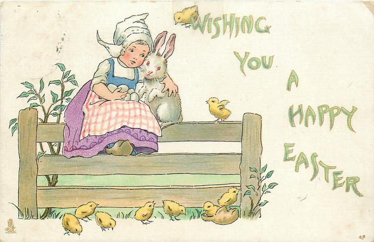 WISHING YOU A HAPPY EASTER  Dutch girl sits on fence, cuddles rabbit, eggs in her lap
