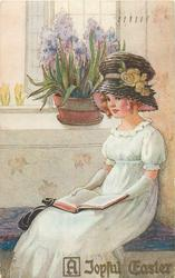 A JOYFUL EASTER  girl in Easter bonnet sits with book on lap below large bowl of blue hyacinths