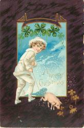 A HAPPY CHRISTMAS  boy in white suit has pig on a string, 4 leaf clover above