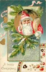A HAPPY CHRISTMAS, insert of Santa's head & shoulders, fir branches around, nuts & fruit below