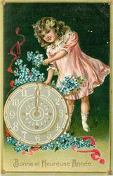 BONNE ET HEUREUSE ANNEE girl stands above clock with blue forget-me-nots