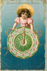 BONNE ET HEUREUSE ANNEE girl leans over top of clock