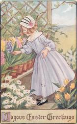 JOYOUS EASTER GREETINGS  girl looks at hyacinths, many other flowers