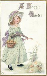 A HAPPY EASTER  girl walks right with basket of chicks