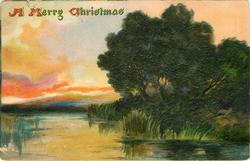 A MERRY CHRISTMAS  rural scene, water left, deep green mass of trees right, no trees left
