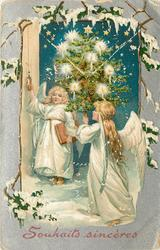 SOUHAITS SINCERES  two angels dressed in white, one carries lighted Xmas tree below