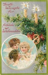 BESTE WUNSCHE FUR FROLICHE WEIHNACHTEN  two candles on tree above round insert of three angel faces