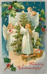FROHLICHES WEIHNACHTSFEST  two angels in white decorate tree
