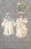 HEUREUSE ANNEE  two girls in white coats walk front in snow, one carries exaggerated four leaf clover