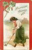 HEUREUSE ANNEE woman strikes ball with golf club, horseshoe upper left