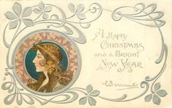 **A HAPPY CHRISTMAS AND A BRIGHT NEW YEAR  head lower left, brown & pink decorations round head, head piece with dangling ornament. she faces & looks left