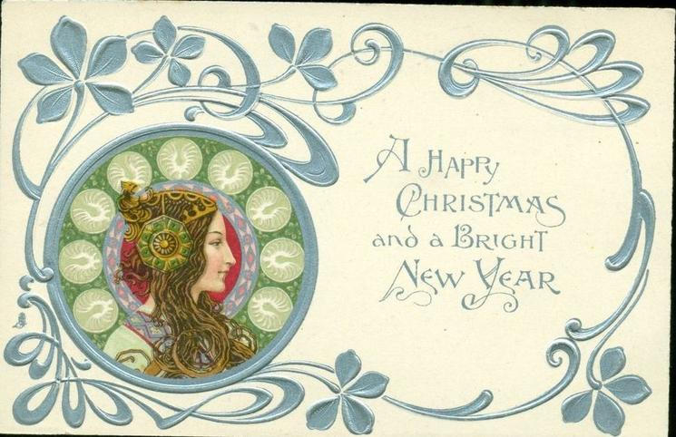 *A HAPPY CHRISTMAS AND A BRIGHT NEW YEAR   head lower left, silver & decorations round head, head-piece with large ornament over ear, she looks & faces right