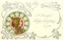 *A PEACEFUL HAPPY CHRISTMAS TO YOU   head upper left, silver & green decorations round head, head-piece with large green ornament over ear, she looks & faces right