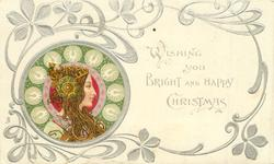*WISHING YOU BRIGHT AND HAPPY CHRISTMAS  head lower left facing right, green or brown decorations round head, head-piece with large ornament over ear, she looks & faces right